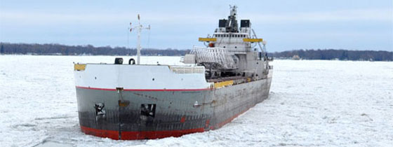 Commercial Ship being escorted through ice by the CCGS Samuel Risley on the St-Clair River, Ontario