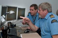 Two employees monitoring marine traffic at a Marine Security Operations Centre