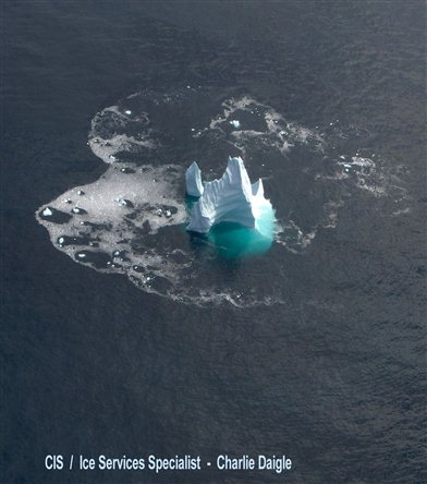 Calving iceberg (Courtesy of the Canadian Ice Service)