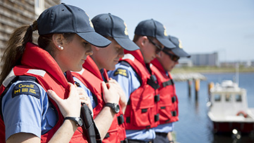 4 Canadian Coast Guard students in line.